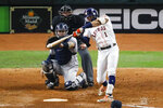 Houston Astros' Carlos Correa hits a walk-off home run against the New York Yankees during the 11th inning in Game 2 of baseball's American League Championship Series Sunday, Oct. 13, 2019, in Houston. (AP Photo/Sue Ogrocki)
