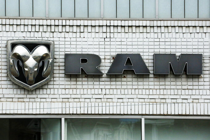 FILE - This Jan. 12, 2017, file photo shows the Ram logo at a Chrysler dealership in Pittsburgh. Fiat Chrysler said Friday, May 28, 2021 that it is recalling more than a half-million heavy-duty Ram trucks to fix a problem that can cause the wheels to fall off. (AP Photo/Gene J. Puskar, File)