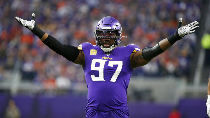 File-Minnesota Vikings defensive end Everson Griffen celebrates a sack during the first half of an NFL football game against the Denver Broncos, Sunday, Nov. 17, 2019, in Minneapolis. The Dallas Cowboys have agreed to a contract with longtime Minnesota defensive end Everson Griffen, a person with knowledge of the deal said Wednesday, Aug. 12, 2020. Griffen is the latest addition of a pass rusher with a pedigree for the Cowboys, who signed former San Francisco end Aldon Smith during the offseason.  (AP Photo/Bruce Kluckhohn, File)