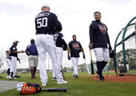 Detroit Tigers first baseman Miguel Cabrera, right, walks from the batting cage at the Tigers spring training baseball facility, Monday, Feb. 18, 2019, in Lakeland, Fla. (AP Photo/Lynne Sladky)