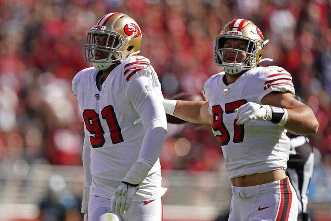 San Francisco 49ers defensive end Arik Armstead (91) is greeted by defensive end Nick Bosa (97) after sacking Carolina Panthers quarterback Kyle Allen during the first half of an NFL football game in Santa Clara, Calif., Sunday, Oct. 27, 2019. (AP Photo/Tony Avelar)