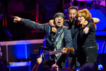 FILE - Bruce Springsteen, center, Stevie Van Zandt, left, and Patti Scialfa perform with the E Street Band at Madison Square Garden in New York on Jan. 27, 2016. Springsteen's latest album,