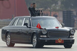 Chinese leader Xi Jinping waves from an open-top limousine during a parade to mark the 70th anniversary of the founding of Communist China, in Beijing, Tuesday, Oct. 1, 2019. (AP Photo/Mark Schiefelbein)