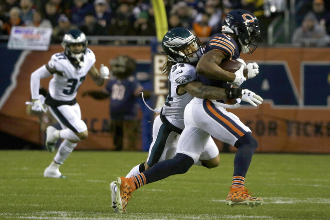 Philadelphia Eagles cornerback Cre'von LeBlanc (34) tackles Chicago Bears wide receiver Anthony Miller (17) during the first half of an NFL wild-card playoff football game Sunday, Jan. 6, 2019, in Chicago. (AP Photo/David Banks)