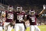 Texas A&M tight end Jalen Wydermyer (85) celebrates with Isaiah Spiller (28) and Hezekiah Jones (9) after a touchdown catch against Arkansas during the second half of an NCAA college football game Saturday, Oct. 31, 2020, in College Station, Texas. (AP Photo/Sam Craft)