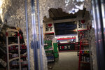 The glass door of a souvenir shop is shattered as people broke into it hours after a solidarity rally calling for justice over the death of George Floyd Monday, June 1, 2020, in New York. Floyd died after being restrained by Minneapolis police officers on May 25. (AP Photo/Wong Maye-E)