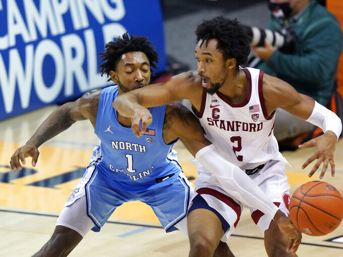 North Carolina guard Leaky Black (1) knocks the ball away from Stanford guard Bryce Wills (2) during the second half of an NCAA college basketball game in the semifinals of the Maui Invitational, Tuesday, Dec. 1, 2020, in Asheville, N.C. (AP Photo/Kathy Kmonicek)