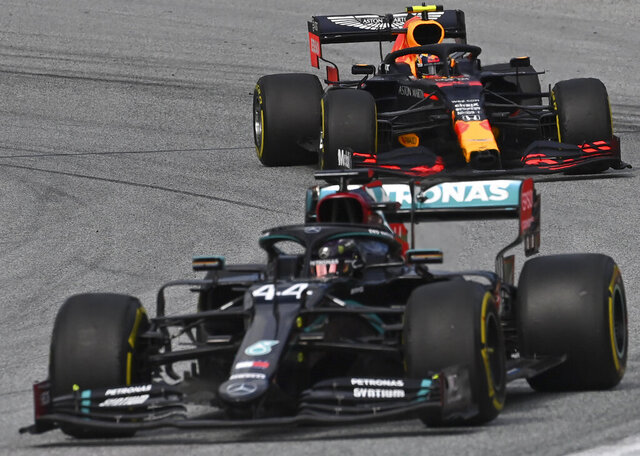 Mercedes driver Lewis Hamilton of Britain steers his car followed by Red Bull driver Alexander Albon of Thailand during the second practice session at the Red Bull Ring racetrack in Spielberg, Austria, Friday, July 3, 2020. The Austrian Formula One Grand Prix will be held on Sunday. (Joe Klamar/Pool via AP)