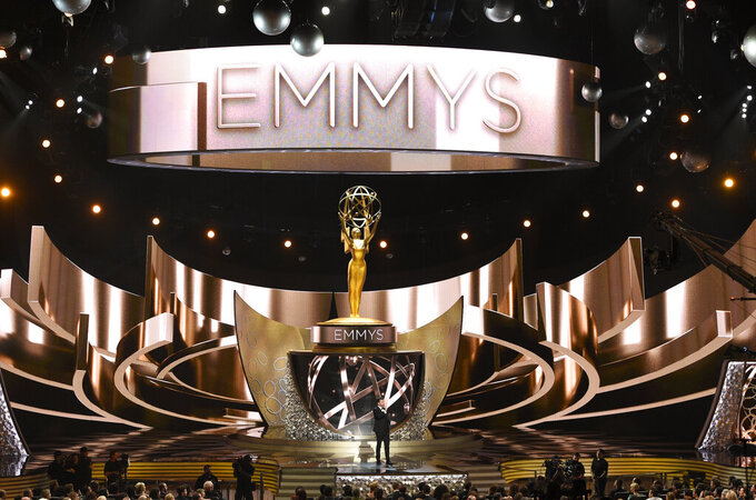 FILE - This Sept. 18, 2016 file photo shows the main stage during the 68th Primetime Emmy Awards in Los Angeles. The 72nd Emmy Awards awards will be conducted remotely and air on ABC with Jimmy Kimmel as host. (Photo by Chris Pizzello/Invision/AP, File)