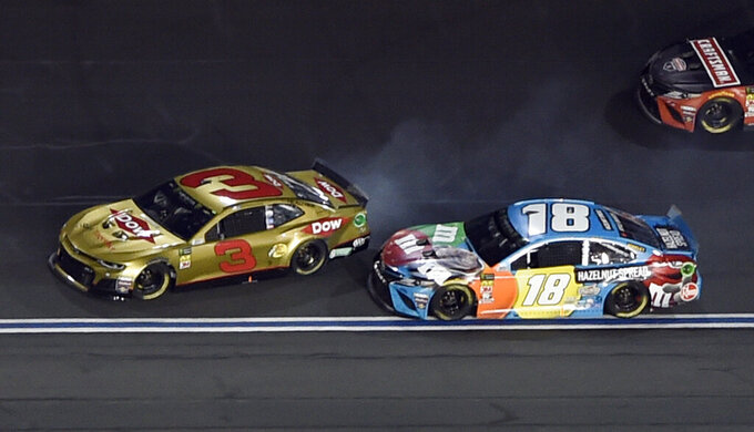 Austin Dillon (3) spins after contact from Kyle Busch (18) during the NASCAR All-Star Race at Charlotte Motor Speedway in Concord, N.C., Saturday, May 18, 2019. (AP Photo/Mike McCarn)