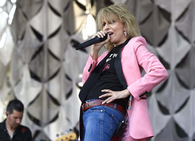 """FILE - Chrissie Hynde, of the Pretenders, performs at the Arroyo Seco Music Festival in Pasadena, Calif. on June 23, 2018. Hynde is featured in """"1971: The Year That Music Changed Everything,"""" an eight-part documentary series that premieres Friday on the Apple+ streaming service. (Photo by Chris Pizzello/Invision/AP, File)"""