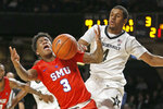 Vanderbilt guard Jordan Wright (4) blocks a shot by SMU guard Kendric Davis (3) during the second half of an NCAA college basketball game Saturday, Jan. 4, 2020, in Nashville, Tenn. (AP Photo/Mark Humphrey)