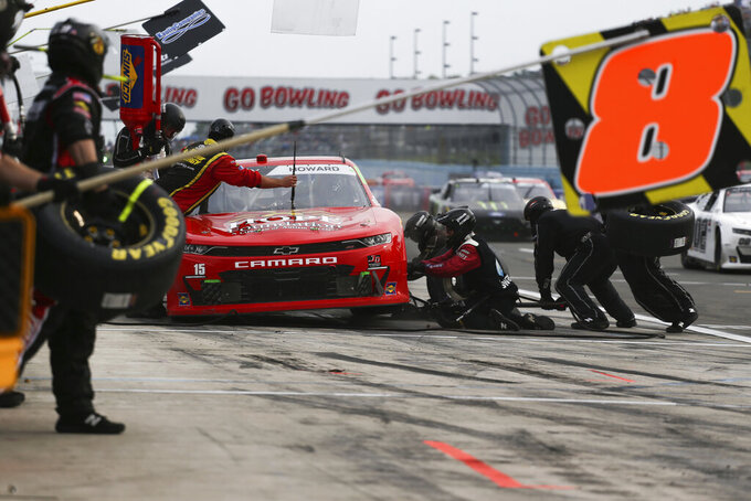 The pit crew works on Colby Howard's car in the final stage of the NASCAR Xfinity Series auto race at Watkins Glen International in Watkins Glen, N.Y., on Saturday, Aug. 7, 2021. (AP Photo/Joshua Bessex)