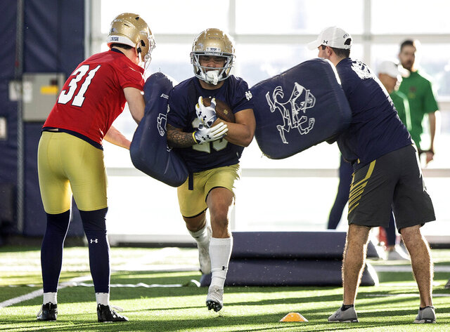 FILE - Notre Dame's running back Kyren Williams runs through a drill during the team's first spring NCAA college football practice at the Irish Athletics Center, Thursday, March 5, 2020, in South Bend, Ind. With all the success Notre Dame has enjoyed its last three seasons, amassing a 33-6 record under coach Brian Kelly, it has been the inability to run the football successfully in big games that has curtailed the championship hopes of the Fighting Irish. No. 10 Notre Dame hopes to change that starting Saturday, Sept. 12 when Duke visits for the 2020 season opener. (Santiago Flores/South Bend Tribune via AP, File)