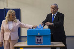 Israeli Prime Minister Benjamin and his wife Sarah casts their votes at a voting station in Jerusalem on September 17, 2019. Israelis began voting Tuesday in an unprecedented repeat election that will decide whether longtime Prime Minister Benjamin Netanyahu stays in power despite a looming indictment on corruption charges. (Heidi Levine, Sipa, Pool via AP).