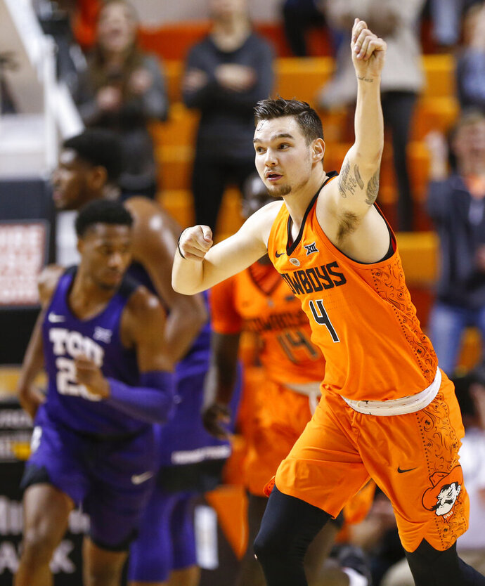 Oklahoma State's Thomas Dziagwa (4) celebrates after making a three-point shot in the second half of a NCAA college basketball game against TCU in Stillwater, Okla., Monday, Feb. 18, 2019. (Nate Billings/The Oklahoman via AP)