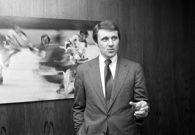 FILE - In this Wednesday, Feb. 6, 1980 file photo, Herb Brooks, coach of the 1980 U.S. Olympic Hockey team, stands in front of a hockey photo at the Hall of Fame Club at Madison Square Garden in New York. The NCAA men's hockey tournament bracket this year would have made Herb Brooks proud. For the first time, all five Division I programs from Minnesota made the 16-team field. Minnesota is the No. 3 overall seed. The Gophers are joined by Minnesota State, Minnesota Duluth, St. Cloud State and Bemidji State. Brooks was a player and coach for Minnesota who went on to Olympic and NHL fame. He also helped launch St. Cloud State's leap to Division I in 1987. Brooks spoke often of his desire to grow the college game in his home state. (AP Photo/Ron Frehm, File)