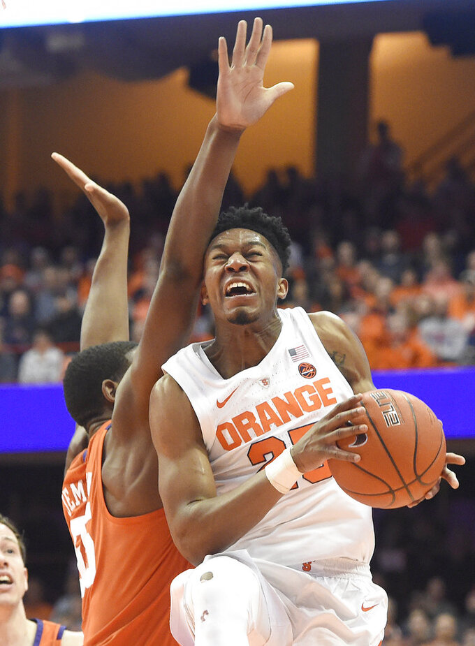 Syracuse guard Tyus Battle (25) drives past Clemson's Trey Jemison during an NCAA college basketball game Wednesday, Jan. 9, 2019, in Syracuse, N.Y. (Dennis Nett/The Post-Standard via AP)