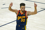 Golden State Warriors guard Stephen Curry celebrates after scoring a 3-pointer against the Utah Jazz during the first half of an NBA basketball game Saturday, Jan. 23, 2021, in Salt Lake City. (AP Photo/Rick Bowmer)