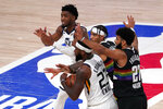 Utah Jazz's Royce O'Neale (23) and Donovan Mitchell, left rear, call for a time out late during the second half an NBA first round playoff basketball game as Denver Nuggets' Jamal Murray (27) and Gary Harris (14) defend, Tuesday, Sept. 1,2020, in Lake Buena Vista, Fla. (AP Photo/Mark J. Terrill)