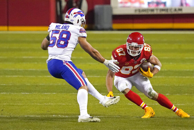 Kansas City Chiefs tight end Travis Kelce (87) runs from Buffalo Bills linebacker Matt Milano (58) after catching a pass during the second half of the AFC championship NFL football game, Sunday, Jan. 24, 2021, in Kansas City, Mo. (AP Photo/Jeff Roberson)