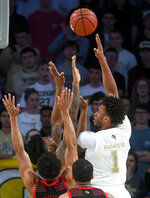 Georgia Tech forward James Banks III (1) puts a shot up over Louisville defenders during the first half of an NCAA college basketball game Saturday, Jan. 19, 2019 in Atlanta. (AP Photo/John Amis)