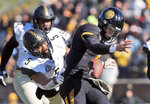 Missouri quarterback Drew Lock, right, fumbles as he is hit by Vanderbilt safety LaDarius Wiley during the first half of an NCAA college football game Saturday, Nov. 10, 2018, in Columbia, Mo. Lock recovered the fumble. (AP Photo/Jeff Roberson)