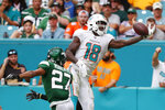 Miami Dolphins wide receiver Preston Williams (18) misses the pass against New York Jets cornerback Darryl Roberts (27) during the second half of an NFL football game, Sunday, Nov. 3, 2019, in Miami Gardens, Fla. (AP Photo/Wilfredo Lee)