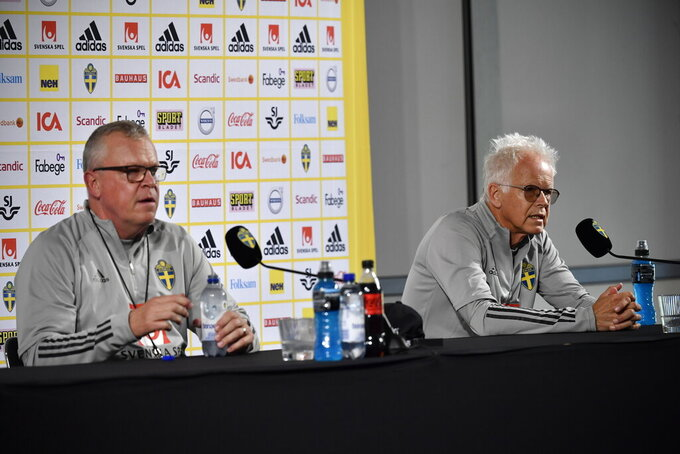 Sweden's National team captain Janne Andersson and Team Physician Anders Valentin take part in a press conference, in Gothenburg, Sweden, Wednesday, June 9, 2021. Euro 2020 gets underway on Friday June 11 and is being played in 11 host cities across 11 countries. The event was delayed by one year after being postponed in 2020 due to the COVID-19 pandemic. (Erik Simander/TT News Agency via AP)