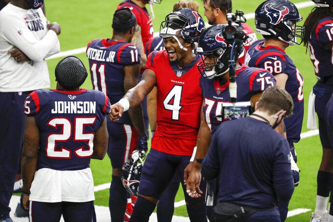 Houston Texans quarterback Deshaun Watson (4) laughs with running back Duke Johnson (25) on the sidelines during NFL football training camp Thursday, Aug. 27, 2020, in Houston. (Brett Coomer/Houston Chronicle via AP, Pool)