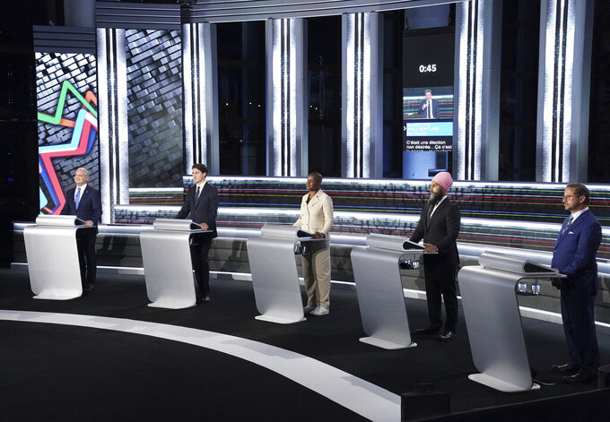 From left to right, Conservative leader Erin O'Toole, Liberal leader Justin Trudeau, Green leader Annammie Paul, New Democratic Party leader Jagmeet Singh and Bloc leader Yves-Francois Blanchet stand at their podiums before the federal election French-language leaders debate, Wednesday, Sept. 8, 2021, in Gatineau, Quebec. (Sean Kilpatrick/The Canadian Press via AP)