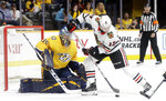 Chicago Blackhawks center Dylan Strome (17) tries to get a shot away in front of Nashville Predators goaltender Pekka Rinne (35), of Finland, during the first period of an NHL hockey game Saturday, April 6, 2019, in Nashville, Tenn. (AP Photo/Mark Humphrey)