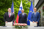 US Secretary of State Mike Pompeo, left, Slovenia's Prime Minister Janez Jansa, center, and Slovenia's Foreign Minister Anze Logar pose for the media after signing an agreement on fifth-generation internet technology in Bled, Slovenia, Thursday, Aug. 13, 2020. Pompeo is on a five-day visit to central Europe with a hefty agenda including China's role in 5G network construction. (Jure Makovec/Pool Photo via AP)