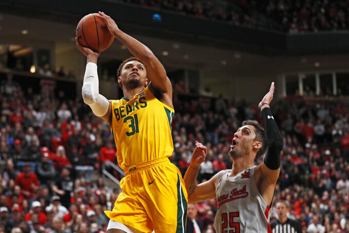 Baylor's MaCio Teague (31) shoots next to Texas Tech's Davide Moretti (25) during the first half of an NCAA college basketball game Tuesday, Jan. 7, 2020, in Lubbock, Texas. (AP Photo/Brad Tollefson)