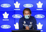 Toronto Maple Leafs forward William Nylander wears a protective mask as he speaks to the media at the NHL hockey team's training camp in Toronto, Wednesday, Sept. 22, 2021. (Nathan Denette/The Canadian Press via AP)