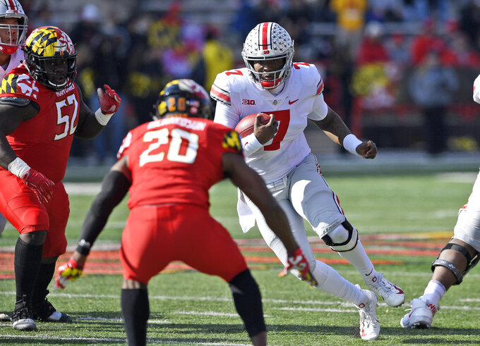 FILE - In this Saturday, Nov. 17, 2018, file photo, Ohio State quarterback Dwayne Haskins Jr. (7) runs with the ball against Maryland defensive back Antwaine Richardson (20) and defensive lineman Oluwaseun Oluwatimi (52) during the first half of an NCAA football game in College Park, Md. Ohio Stat coach Urban Meyer, says Haskins wasn't a fully legitimate leader until he showed he was willing to run the ball two weeks ago in the narrow overtime win over Maryland.(AP Photo/Nick Wass, File)