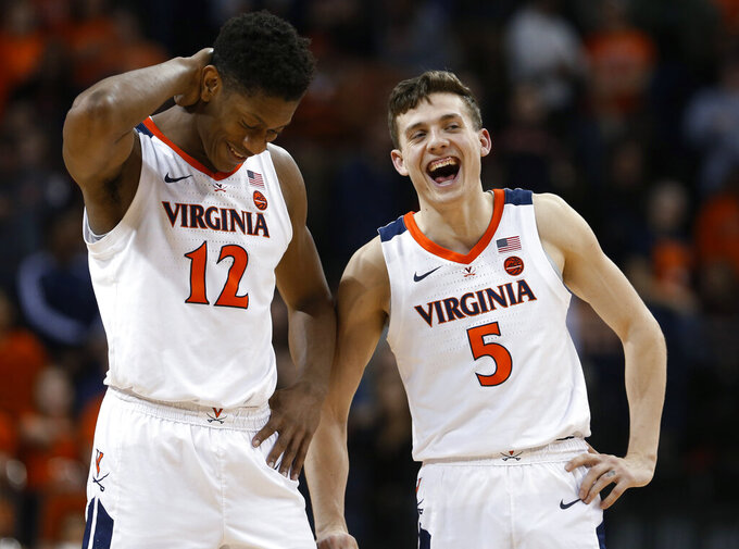 Virginia guard Kyle Guy (5) and guard De'Andre Hunter (12) laugh during the second half of the team's NCAA college basketball game against Georgia Tech in Charlottesville, Va., Wednesday, Feb. 27, 2019. Virginia won 81-51. (AP Photo/Steve Helber)