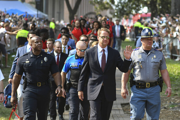 Mississippi head coach Lane Kiffin leads the team on its walk through the Grove before an NCAA college football game against Austin Peay in Oxford, Miss., Saturday, Sept. 11, 2021. (AP Photo/Bruce Newman)