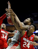 Ohio State's Kaleb Wesson (34) and Andre Wesson (24) battle with Houston's Breaon Brady, center, for a loose ball during the first half of a second round men's college basketball game in the NCAA Tournament Sunday, March 24, 2019, in Tulsa, Okla. (AP Photo/Charlie Riedel)