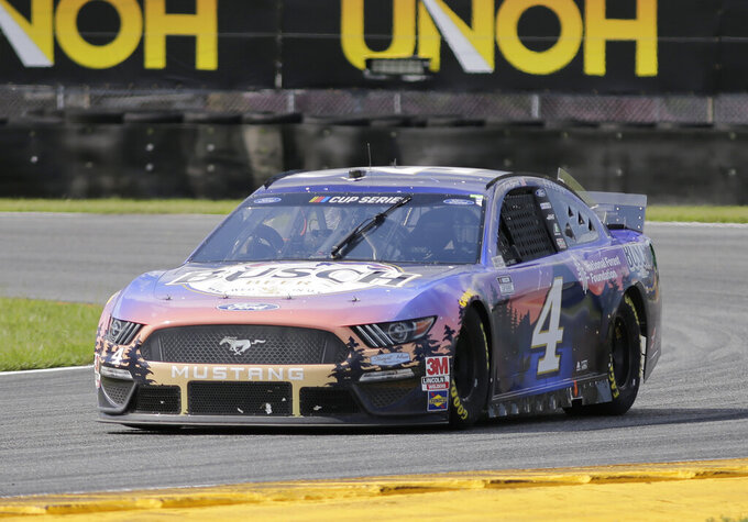 Kevin Harvick drives through Turn 3 during a NASCAR Cup Series auto race at Daytona International Speedway, Sunday, Aug. 16, 2020, in Daytona Beach, Fla. (AP Photo/Terry Renna)