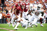 Oklahoma quarterback Kyler Murray (1) scrambles against Texas during the first half of an NCAA college football game at the Cotton Bowl, Saturday, Oct. 6, 2018, in Dallas. (AP Photo/Cooper Neill)