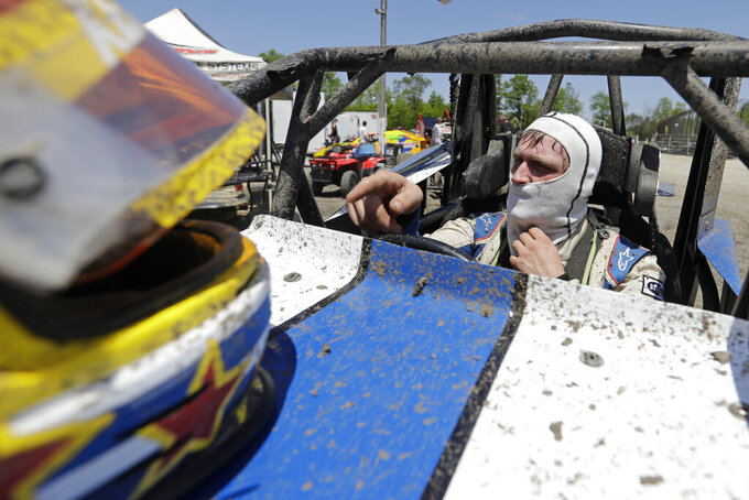 Cole Ketchum waits in his car before a practice session at Gas City I-69 Speedway, Sunday, May 24, 2020, in Gas City, Ind. (AP Photo/Darron Cummings)