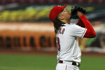 Cincinnati Reds' Luis Castillo reacts as he walks to the dugout in the fifth inning during a baseball game against the Milwaukee Brewers in Cincinnati, Monday, Sept. 21, 2020. (AP Photo/Aaron Doster)