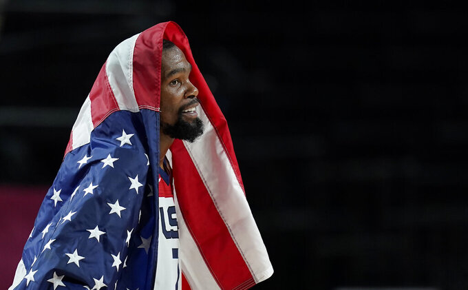 United States' Kevin Durant (7) celebrates after their win in the men's basketball gold medal game against France at the 2020 Summer Olympics, Saturday, Aug. 7, 2021, in Saitama, Japan. (AP Photo/Charlie Neibergall)