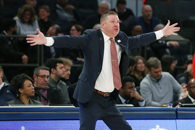 Texas Tech head coach Chris Beard gestures during the first half of an NCAA college basketball game against Louisville in the Jimmy V Classic, Tuesday, Dec. 10, 2019, in New York. (AP Photo/Kathy Willens)