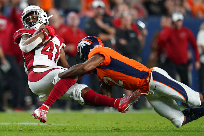 Arizona Cardinals defensive back Nate Brooks (41) is tackled by Denver Broncos wide receiver Brendan Langley (12) after an interception during the first half of an NFL preseason football game, Thursday, Aug. 29, 2019, in Denver. (AP Photo/Jack Dempsey)