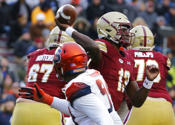 Boston College quarterback Anthony Brown (13) passes under pressure during the second half of an NCAA college football game against Syracuse, Saturday, Nov. 24, 2018, in Boston. (AP Photo/Mary Schwalm)