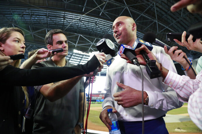 Miami Marlins baseball team CEO Derek Jeter, right, speaks to members of the media inside Marlins Park stadium, Monday, Feb. 11, 2019, in Miami. Jeter is entering his second season as CEO of the Marlins, who remain in the throes of a rebuilding project. (AP Photo/Wilfredo Lee)