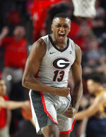 Georgia forward E'Torrion Wilridge (13) reacts after a basket during the second half of an NCAA college basketball game against LSU Saturday, Feb. 16, 2019, in Athens, Ga. LSU won 83-79. (AP Photo/John Bazemore)