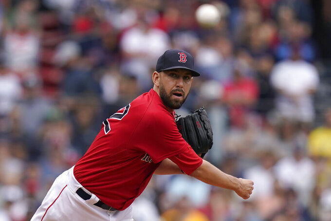 Boston Red Sox's Matt Barnes throws to first in a pick-off attempt in the ninth inning of a baseball game against the New York Yankees, Sunday, July 25, 2021, in Boston. The Red Sox won 5-4. (AP Photo/Steven Senne)